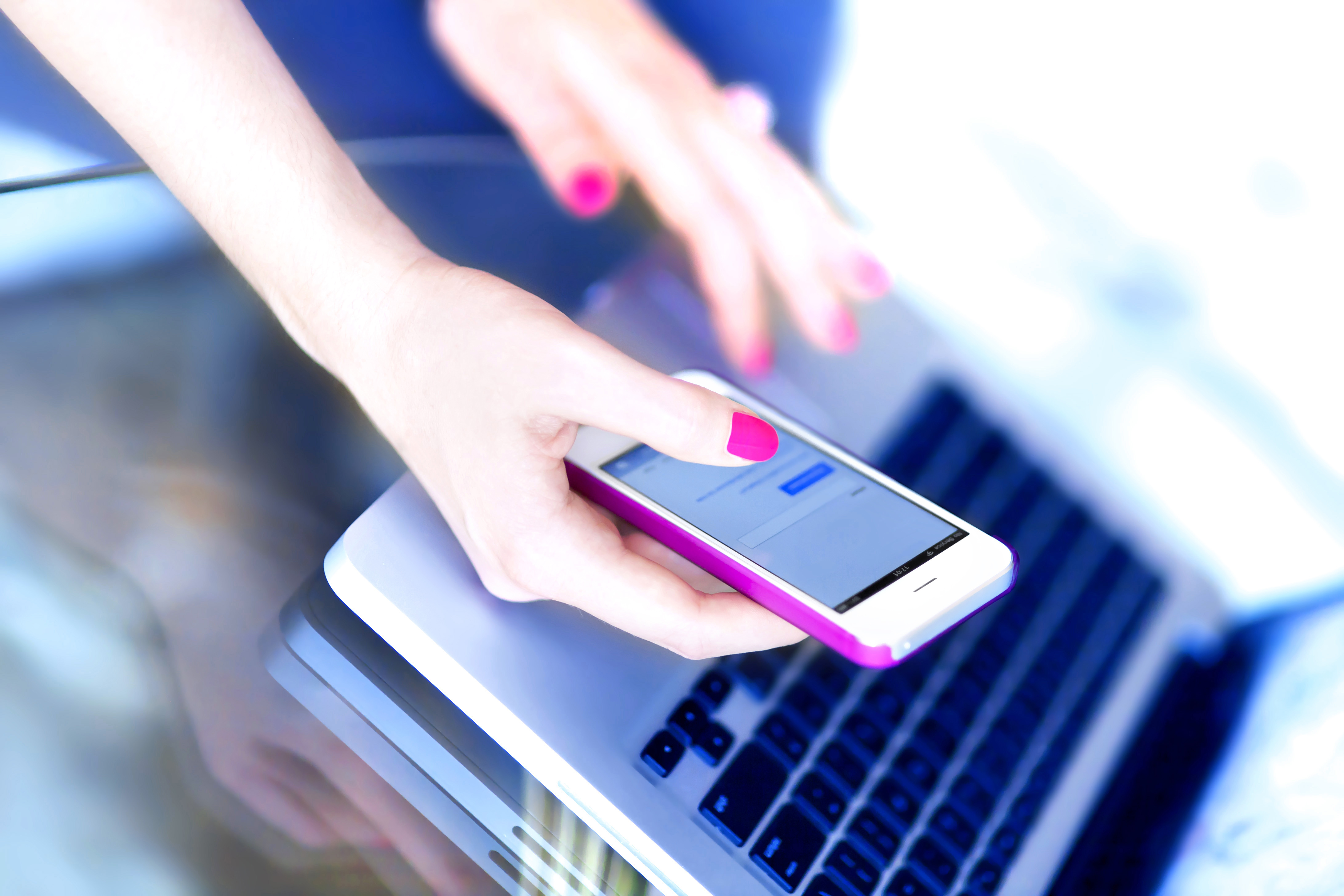 woman using phone and computer_shutterstock_138346775_ Don Pablo